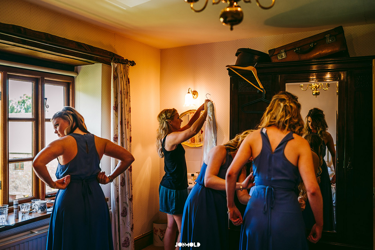 Bride hanging veil up